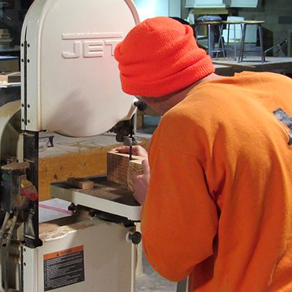 Incarcerated student working on a drill press