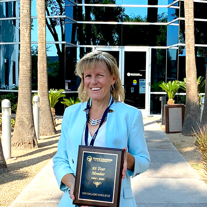 President Smith holding plague in front of Rio Salado Tempe headquarters